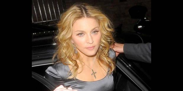 Madonna refuse au père présumé de voir sa fille adoptée - La DH