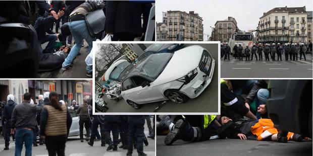 Manifestation interdite à Bruxelles: une Audi A1 force un barrage et fonce sur une personne, le passager de la voiture f...