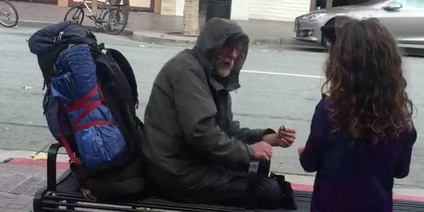 Une petite fille donne son repas à un sans-abri - La DH