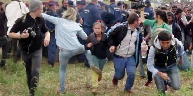 """La journaliste hongroise qui a frappé des migrants dit avoir """"paniqué"""" - La DH"""