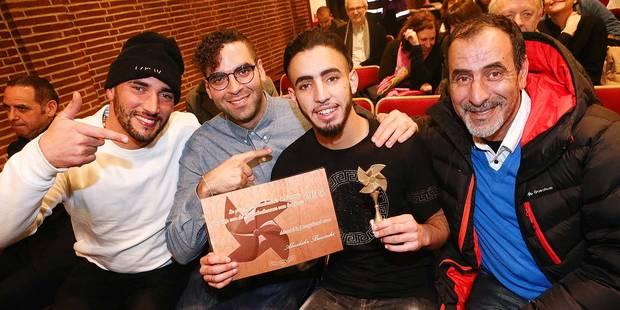 Photos Bernard Demoulin: Le prix du Molenbeekois de l ' annee 2015. Aboubaka Bensaihi avec ses realisateur et son Papa pour le film Black