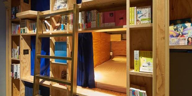 Insolite : une auberge imbriquée dans une bibliothèque - La DH