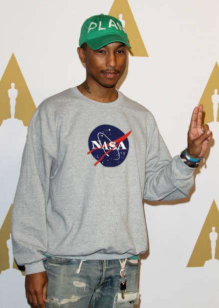 Pharrell Williams, présent pour soutenir le film dont il est l'un des producteurs «Les Figures de l'Ombre»