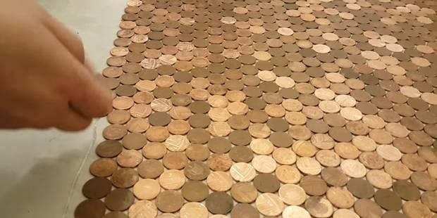 Il recouvre le sol de son magasin avec 1500 euros en pièces de 1 cent - La DH