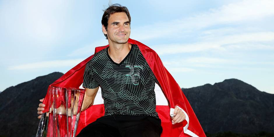 INDIAN WELLS, CA - MARCH 19: Roger Federer of Switzerland poses for photographers after defeating Stan Wawrinka of Switzerland during the men's final of the BNP Paribas Open at the Indian Wells Tennis Garden on March 19, 2017 in Indian Wells, California. Matthew Stockman/Getty Images/AFP == FOR NEWSPAPERS, INTERNET, TELCOS & TELEVISION USE ONLY ==
