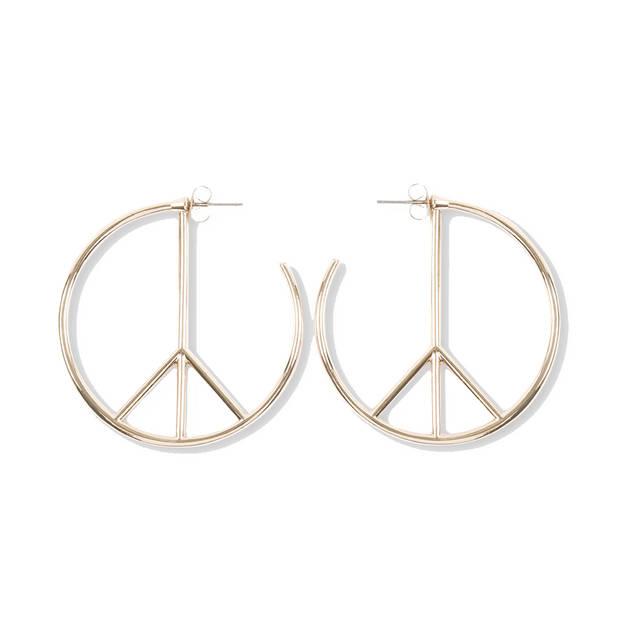 Boucle d'oreilles paul Smith en forme de signe de la paix, 115€