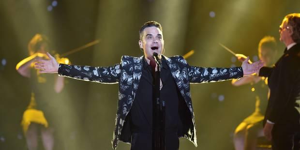 Robbie Williams et Black Eyed Peas au concert de charité de Manchester - La DH
